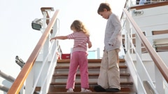 Children are going up ladder on deck of ship and disappearing Stock Footage