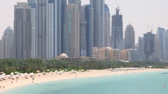 General view on beach and skyscrapers of Dubai city Stock Footage