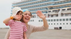 Woman and little girl smiling on moorage Stock Footage