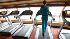 back view on woman running in gym - stock footage