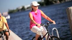 Seniors Fun Day Cycling Stock Footage