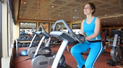 Woman training on exercise bicycle Stock Footage