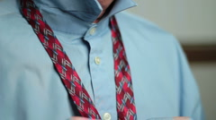 Man Tying Necktie Stock Footage