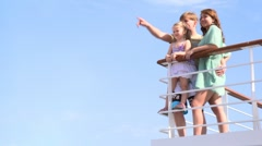 Family is standing at railing on deck Stock Footage