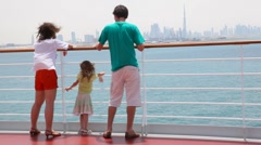 Family is standing on deck of cruise ship Stock Footage