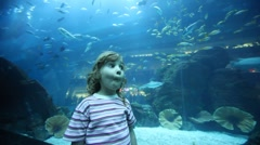 Girl on close shot standing in oceanarium Stock Footage