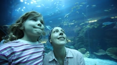 Woman and girl on close shot in oceanarium Stock Footage