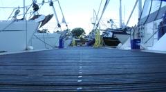 Walk down marina walkway 02 Stock Footage