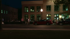 Sidewalk cafe at night in suburban downtown Stock Footage