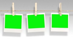 Green screen - polaroids on a line - mpeg Stock Footage