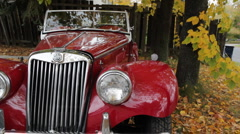 Old red MG convertible. Stock Footage