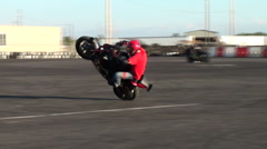 Stunt motorcycle rider doing tricks Stock Footage