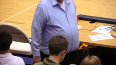Obesity Overweight Man at Sporting Event Stock Footage
