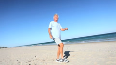 Fun Exercise on the Beach Stock Footage