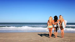 Girlfriends With Surf Boards on Beach Stock Footage