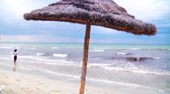 Thatched beach umbrellas in Tunisia - stock footage