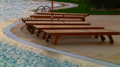 Deckchair near the swimming pool Stock Footage