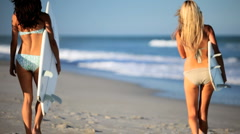 Beautiful Girls with Surf Boards - stock footage