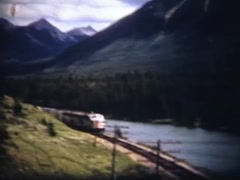 archival, 1950s passenger train in the Rocky Mountains - stock footage
