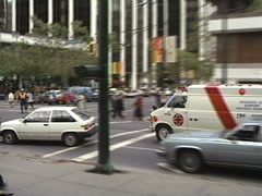 Late 1980s vintage ambulance in downtown Vancouver traffic Stock Footage