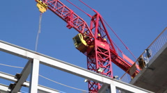 Red tower crane. Closeup. Stock Footage