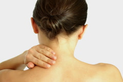 Woman massaging her neck, isolated Stock Footage