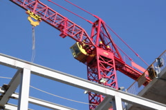 Red tower crane. Medium. SD. Stock Footage