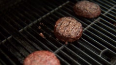 Man flipping burger on a BBQ. Stock Footage