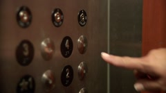 Woman's finger pressing elevator button Stock Footage