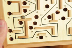 Guiding a ball through a maze. SD. Stock Footage