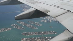 Plane flying from window florida Stock Footage
