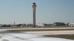 Control tower from plane in miami Stock Footage