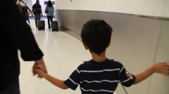 Kid with mom in airport1 Stock Footage
