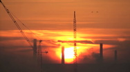 Sunrise with cranes and industrial landscape Stock Footage