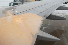 De-icing the plane. SD. Stock Footage