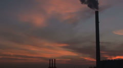 A sunset with the tower and steam in an industrial landscape Stock Footage
