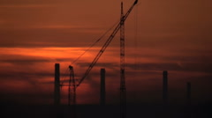Timelapse with cranes and industry in a morning sunrise Stock Footage