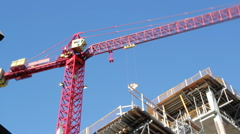 Red crane at work. Timelapse. Stock Footage