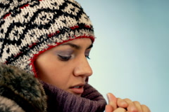 Woman in woolen cap feels cold  Stock Footage