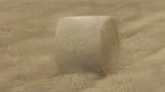 Straw bale, zoom out & rack focus to rain on window. Stock Footage