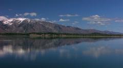 Pan Tetons reflecting on Lake Stock Footage