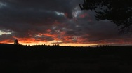 Brilliant Orange Clouds after sunset WS Stock Footage