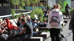 NYC HIGHLINE CROWD IN LATE AFTERNOON SUNLIGHT - stock footage