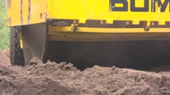 Vibratory roller, low angle, extreme close up Stock Footage