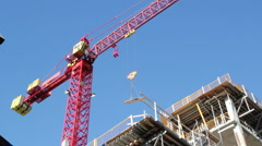 Red crane at work. Stock Footage