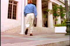 Man walking toward courthouse steps. Stock Footage