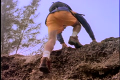 Man climbing a cliff. Stock Footage