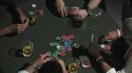Stock Video Footage of Over head shot of a poker game.