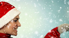 Woman in santa cap catching falling snow  Stock Footage