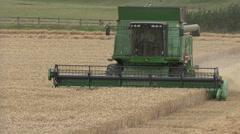 John Deere combine harvester on wheat, head on. Stock Footage
